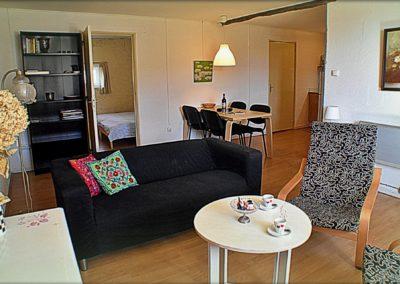Gîte Tardes de salon en doorkijkje naar slaapkamer